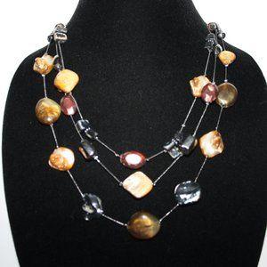 Beautiful gun metal and shell layered necklace